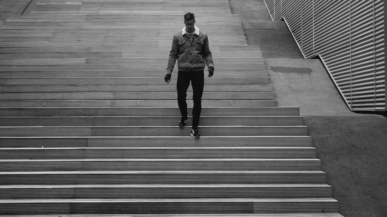 A man walking down a stairs. Copenhagen