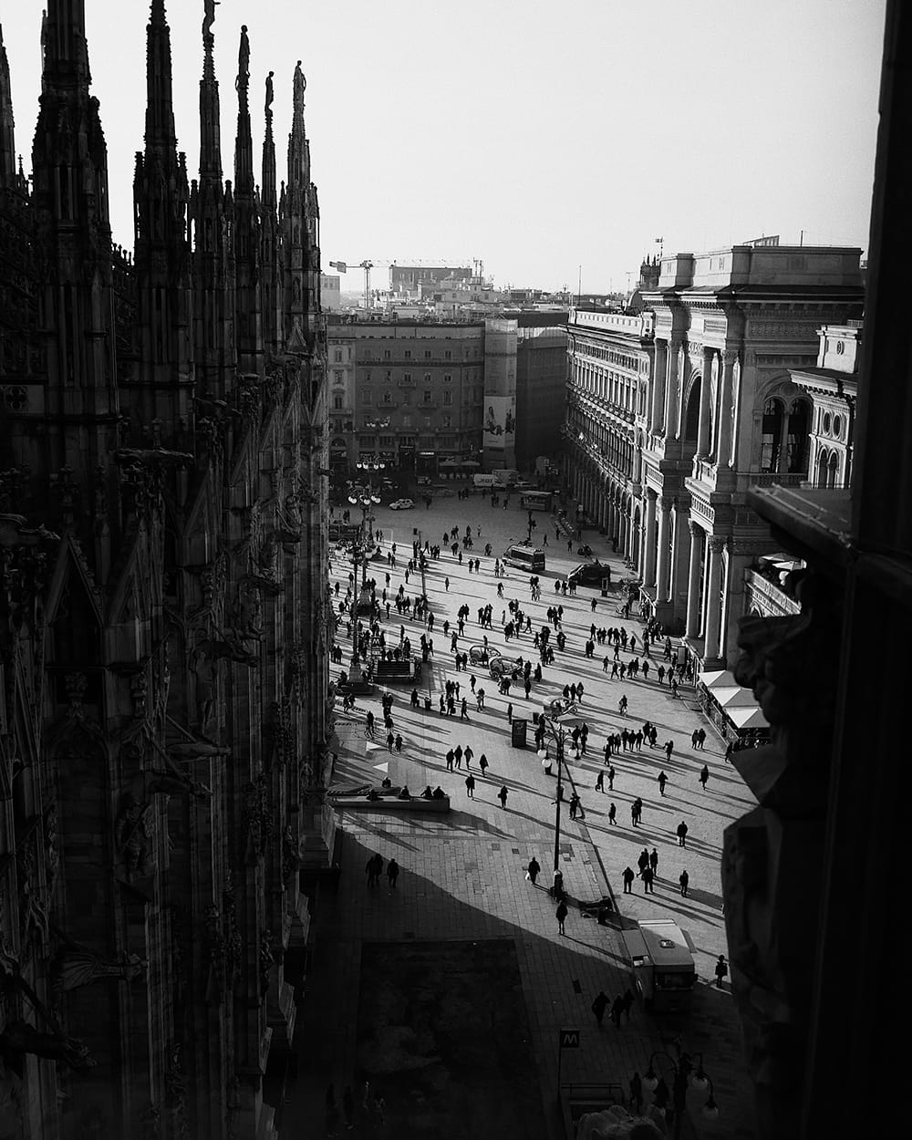 View from a bird's eye on people walking around a square. Milan, Italy