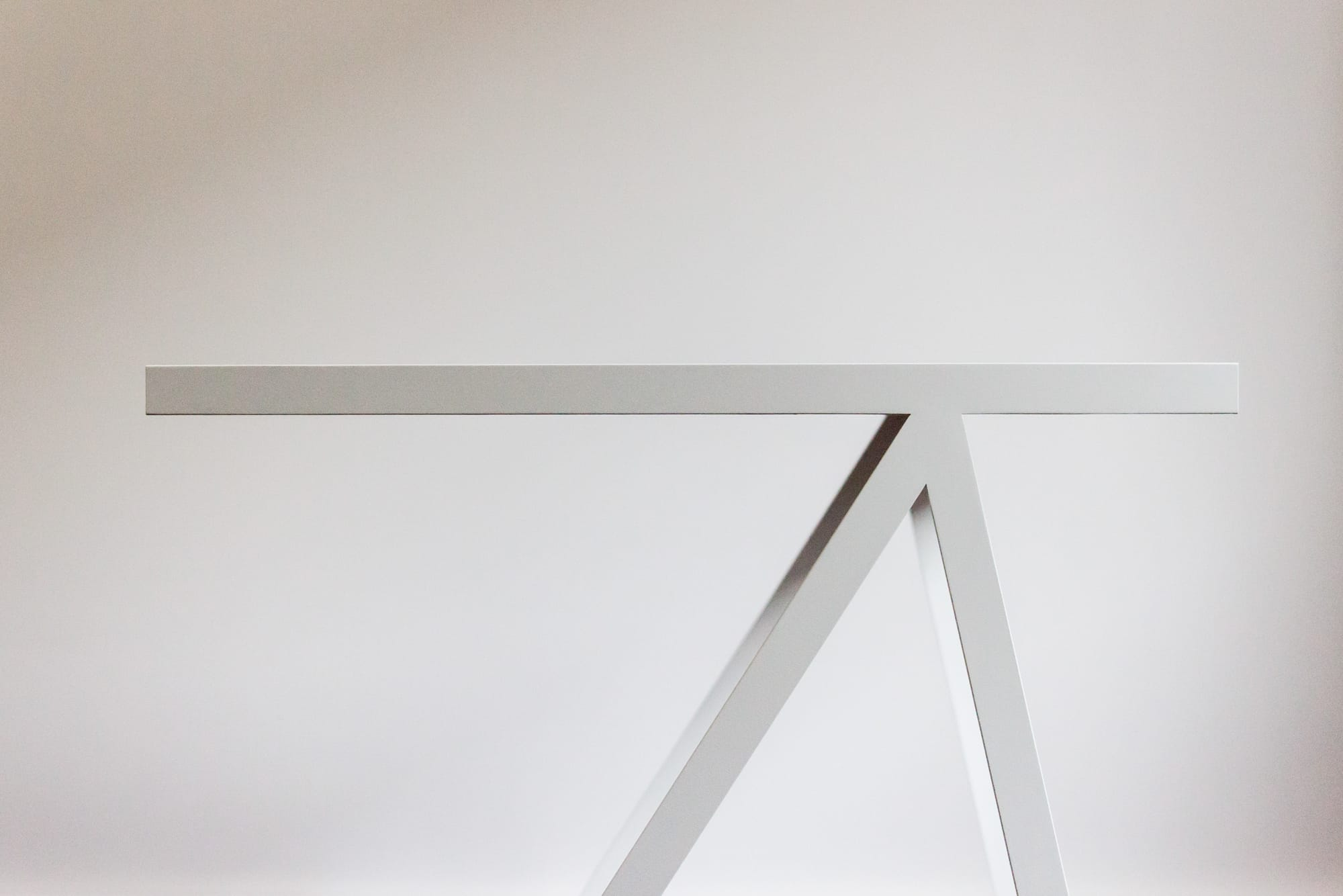 Simple, clean desk profile. Furniture is white and the background is also white. borcas brand