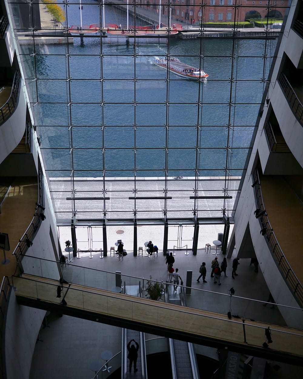 Spacious interior of a staircase with glass wall. Copenhagen