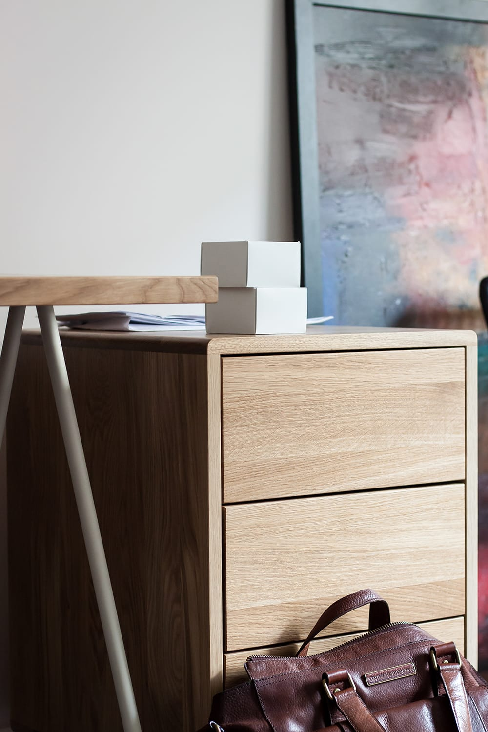 Wooden, simple cabinet among office items. borcas brand
