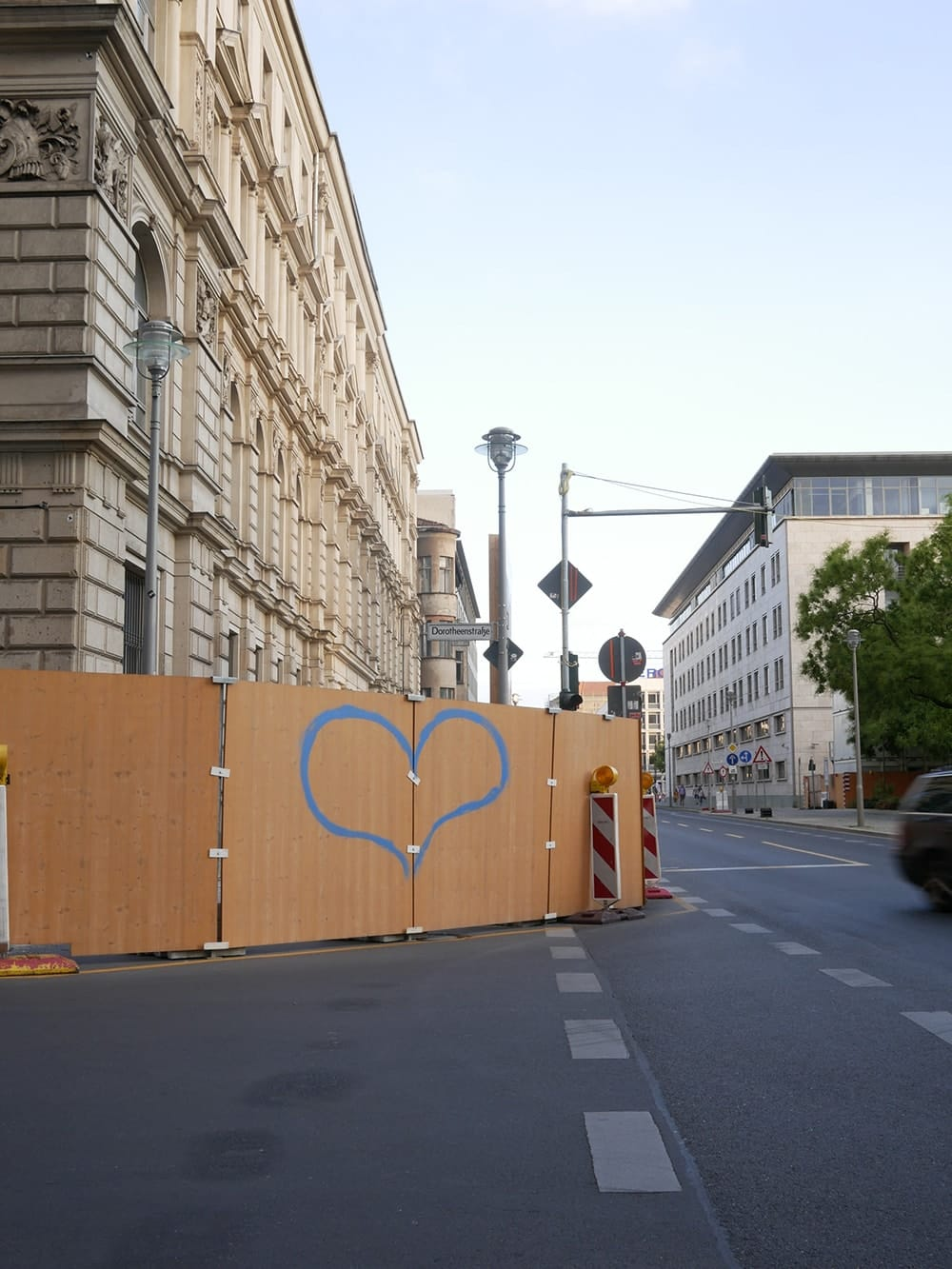 Big shape of heart painted on a construction fence. Berlin