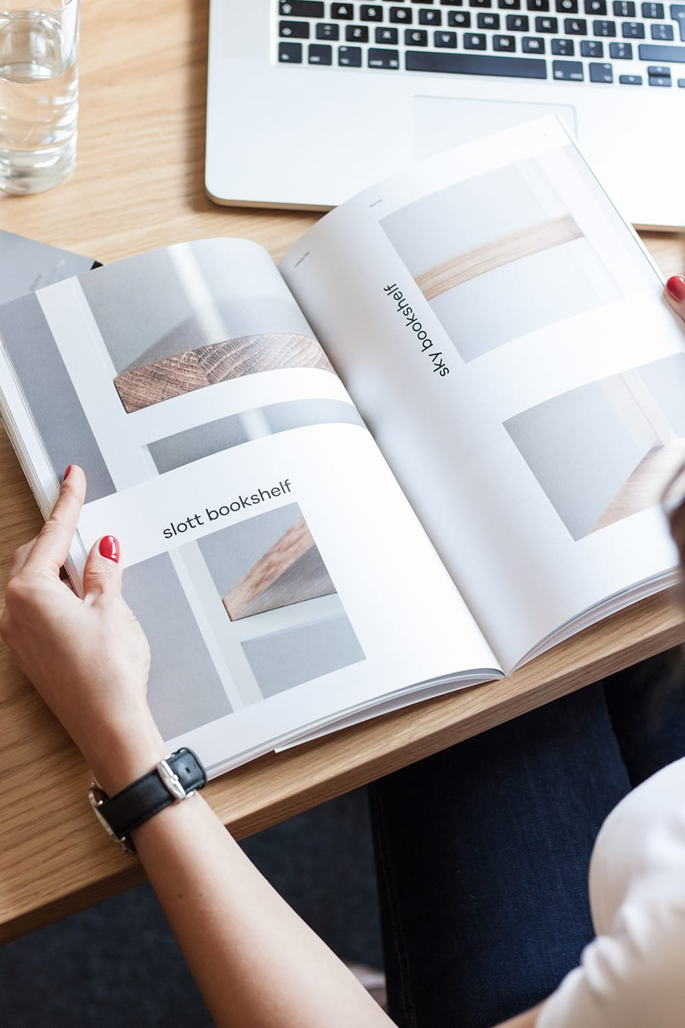 A woman reading brand catalogue in an office. borcas brand