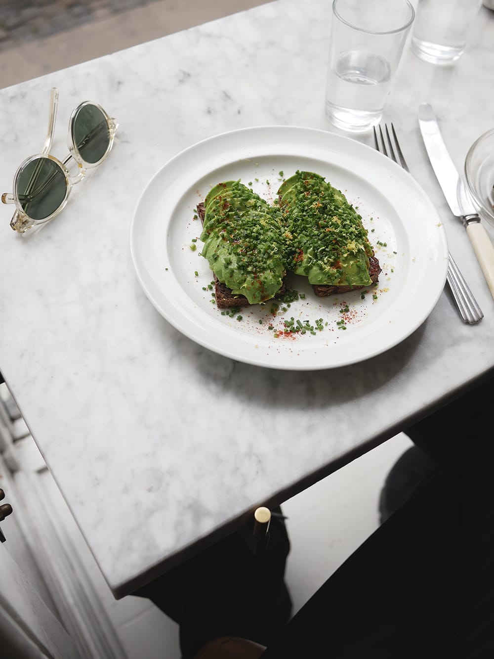 Two toasts with avocado on a marble table top. Copenhagen