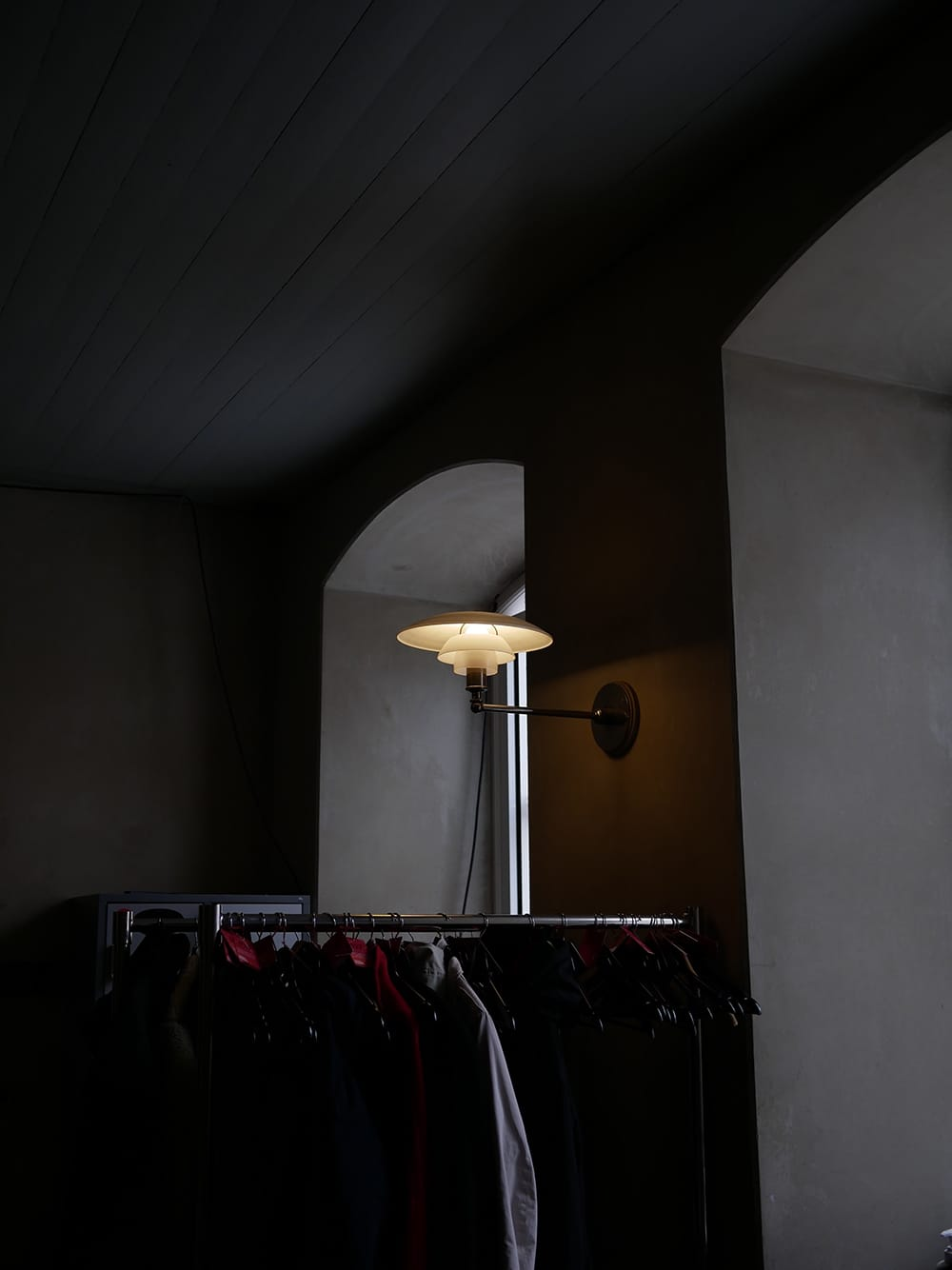 A design lamp shining in a dark cloakroom. Copenhagen