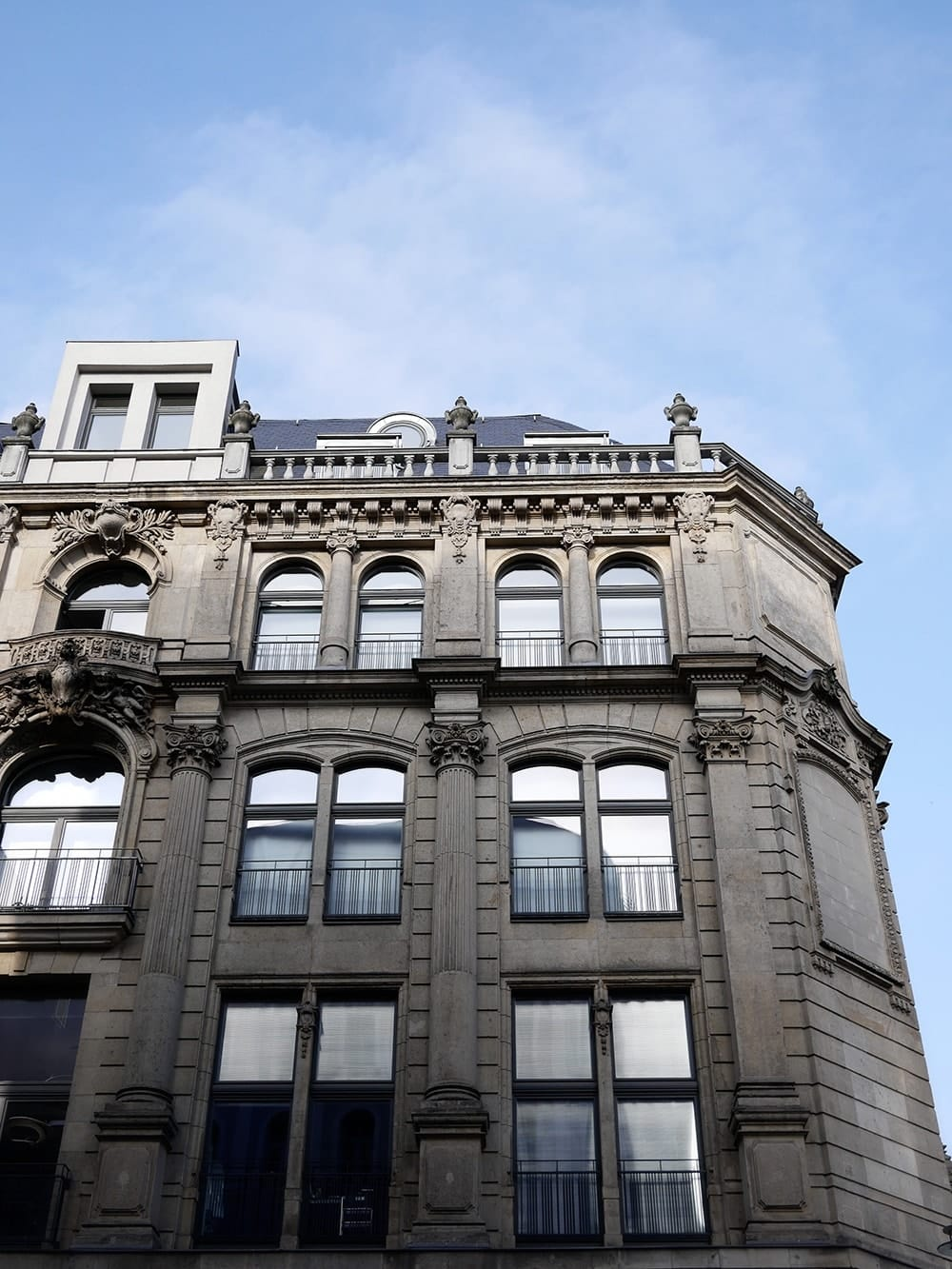 Classical grey facade of old tenement in the city. Berlin
