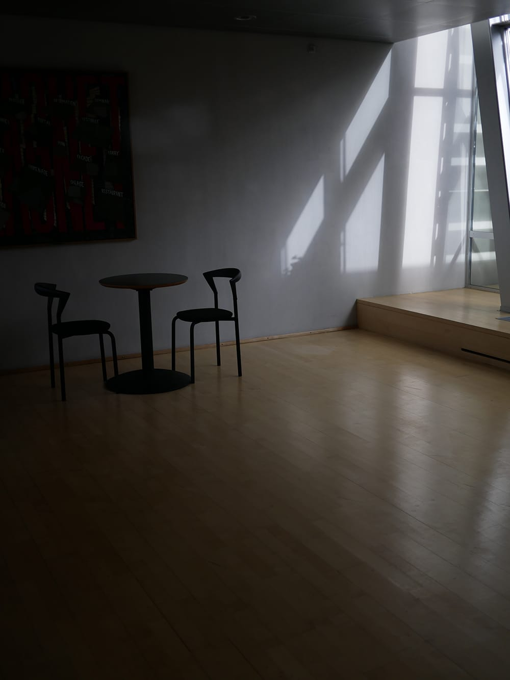 Shaded interior with two chairs and table in the corner. Copenhagen
