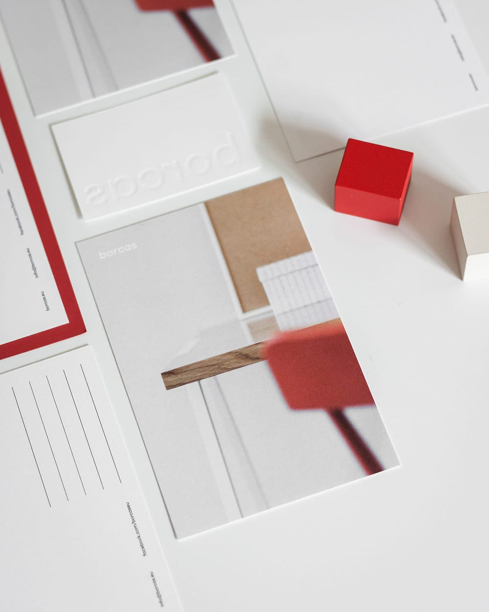 Couple of branding stationery placed on a white table. borcas brand