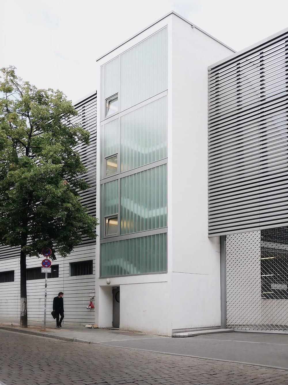 Glass staircase with glazed facade of white building. Berlin