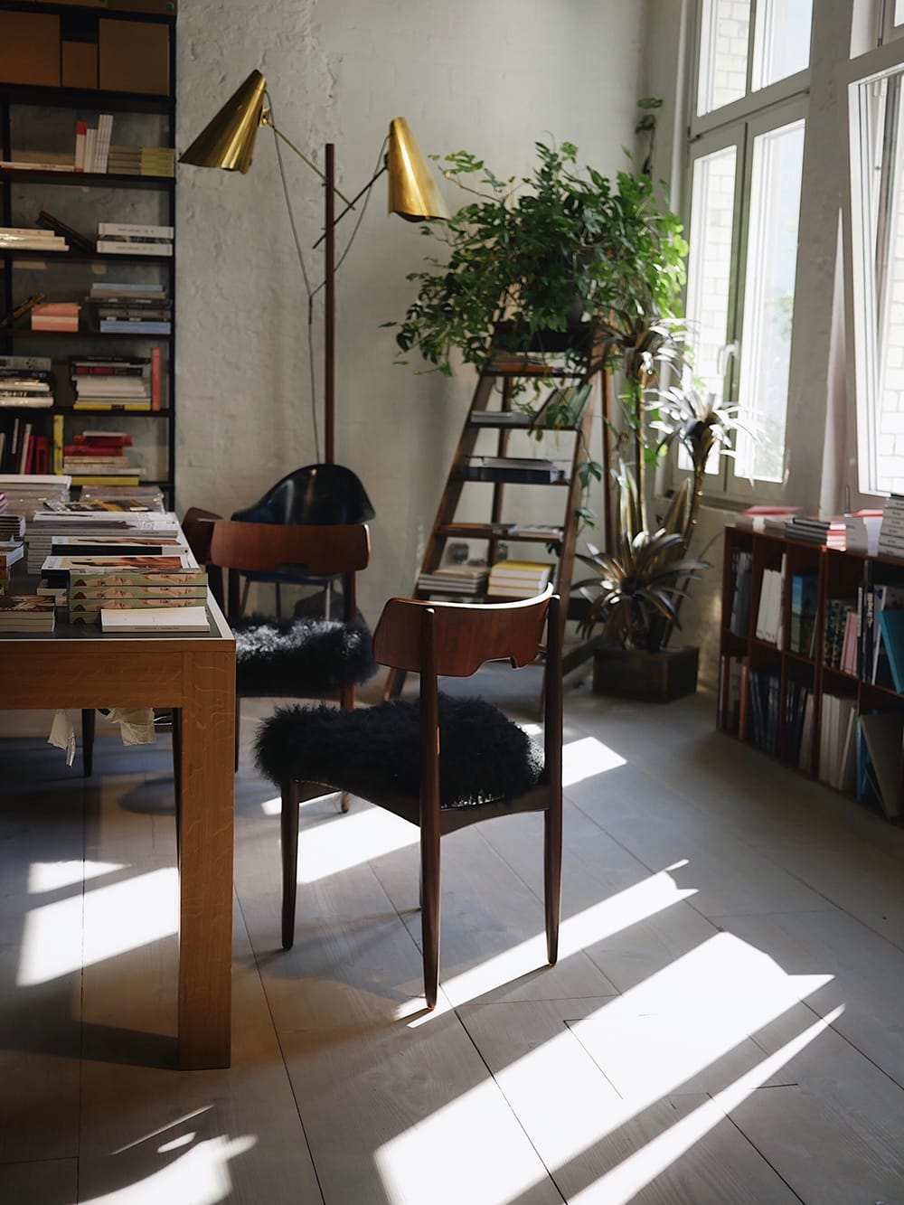 An interior of a design store with a vintage chair placed in the middle. Berlin