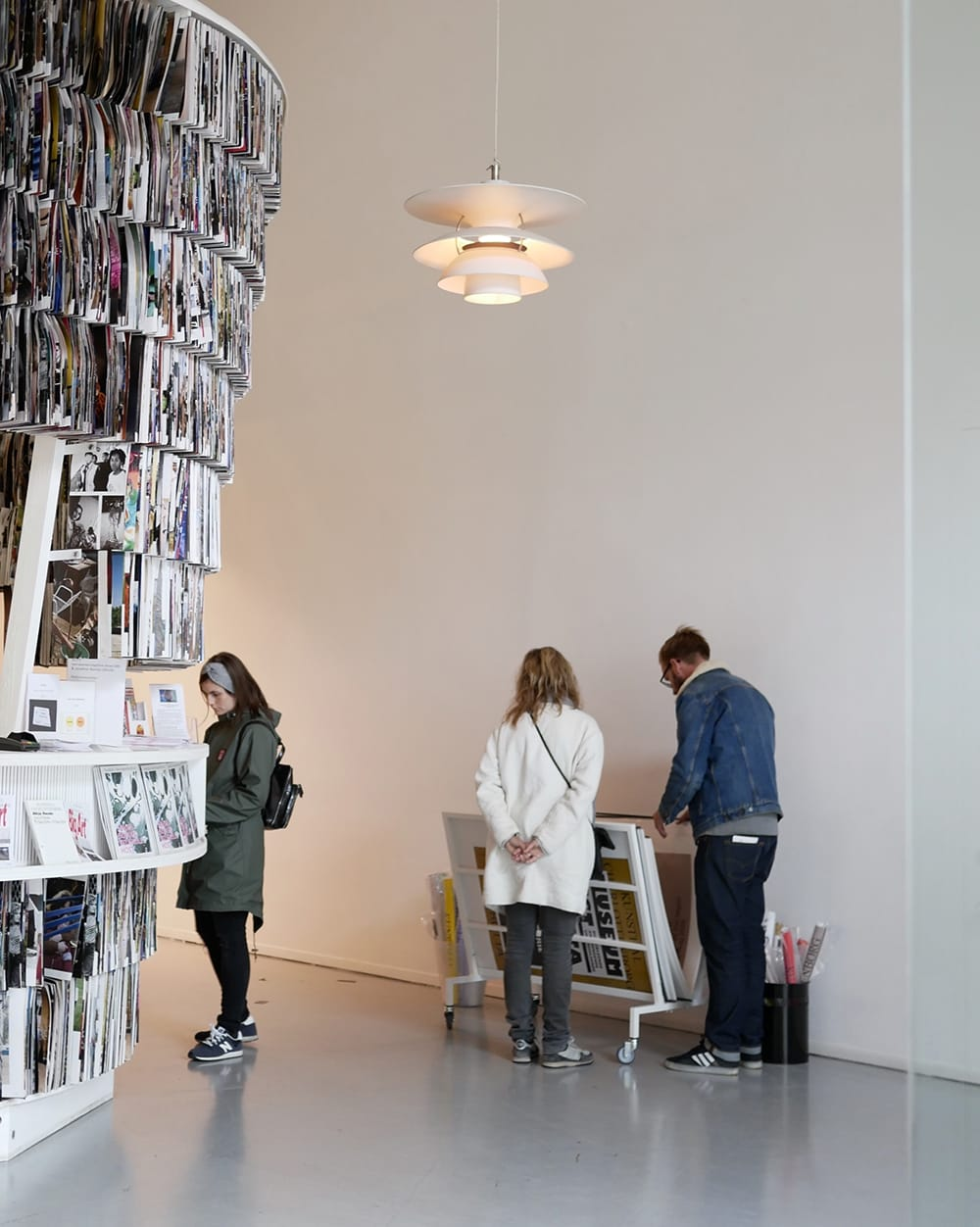 Several visitors browsing posters in a design store. Copenhagen