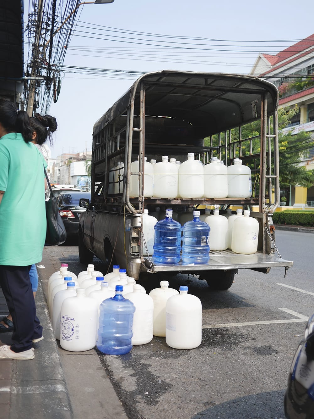Worn-out truck with water pots. Bangkok